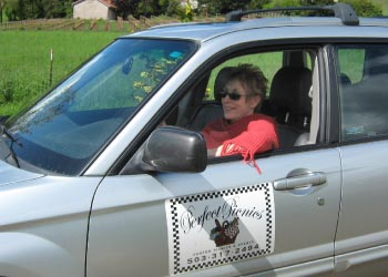 Sharon of Perfect Picnics  					delivering an order in the business vehicle